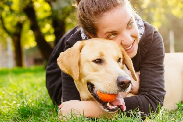 embracing a dog